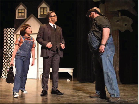"Paige Fraley as Scout,Barry Dailey as her father,Atticus Finch,and Parr Thacker as Walter Cunningham are shown during the Paramount Players' dress rehearsal of ""To Kill a Mockingbird"" on Wednesday."