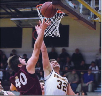 Ashland's Daniel Heaberlin puts up a shot as Russell's Landon Brewer applies pressure.