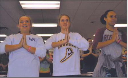 Brailey Oney, Emory Kirk and Mallory Allen practice a traditional Indian dance.